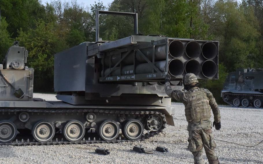 Staff Sgt. Robert Chronister, a section chief with the 41st Field Artillery Brigade, ensures practice rockets are loaded in the Multiple Launch Rocket System before a crew recertification training exercise at Grafenwoehr, Germany, May 8, 2020.