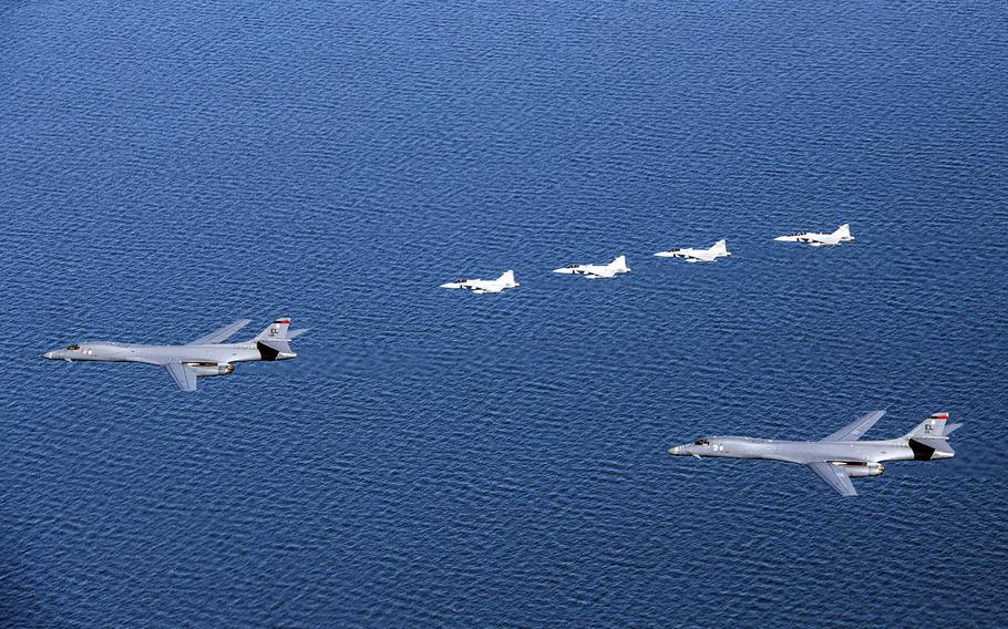 A pair of U.S.-based B-1B bombers fly beside four Swedish Armed Forces Gripen fighter jets for the first time over Sweden during training May 19, 2020.