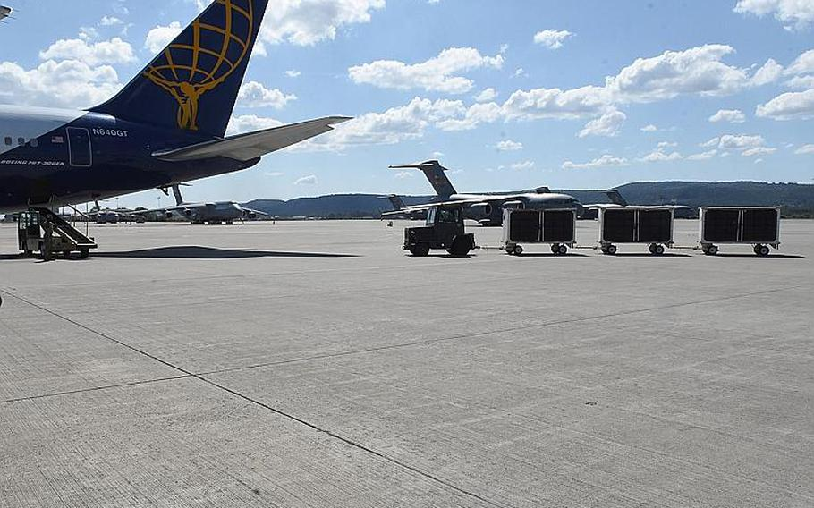 Animals belonging to military personnel are driven out to an airliner contracted to transport servicemembers, their families and pets, on Friday, May 29, 2020, at Ramstein Air Base, Germany.