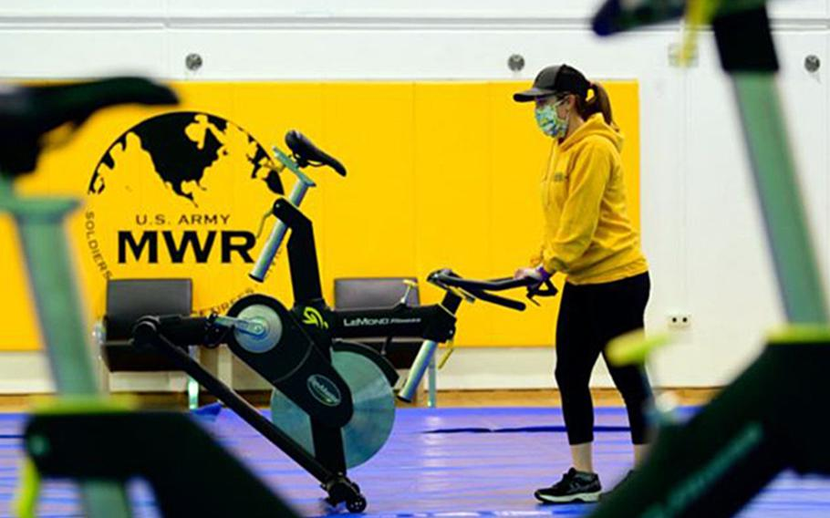 A fitness center employee on Panzer Kaserne maneuvers a spin bike to set up physically distanced spin classes. Gyms in the Stuttgart military community are expected to reopen Monday after being closed for months during the coronavirus pandemic.