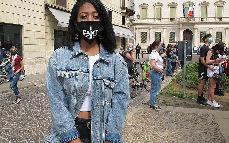 I'ziae Frazier, 18, and a student at Vicenza High School within U.S. Army Garrison Italy, came to the protest with friends just hours ahead of her high school graduation. She will matriculate at Howard University in Washington, D.C. in the fall.