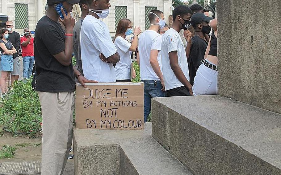 Demonstrators in Vicenza, Italy, on Saturday, June 6, 2020, spent two hours listening to speeches and music as they protested the death of George Floyd, the latest African American killed by police. The young men pictured here are Italian.