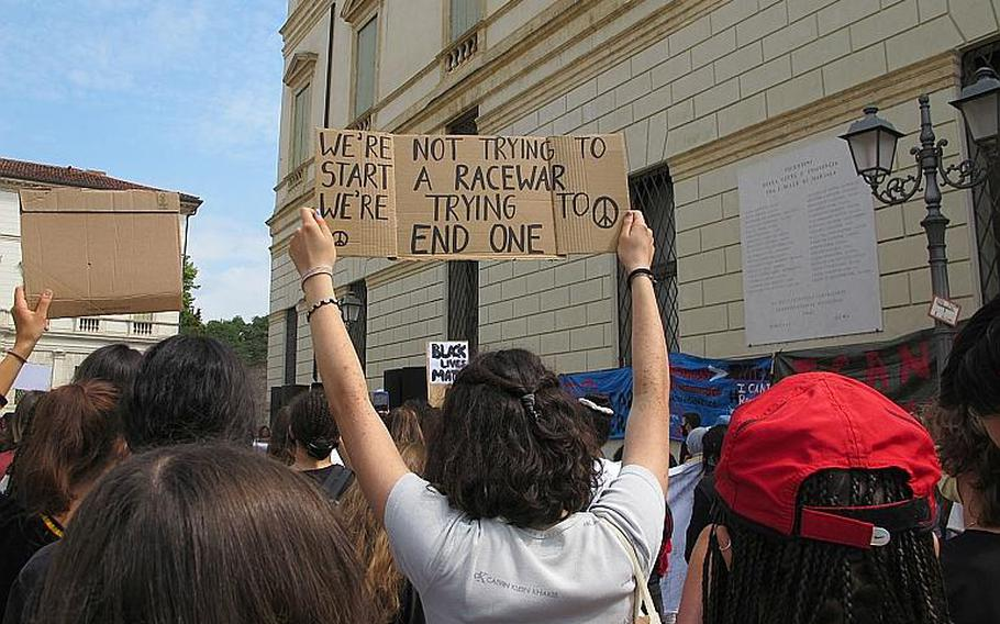 Protesters in Vicenza, Italy on Saturday, June 6, 2020 against U.S. racism and police brutality, sparked by the police killing of George Floyd, held aloft variety of signs as they listened to speakers and singers.