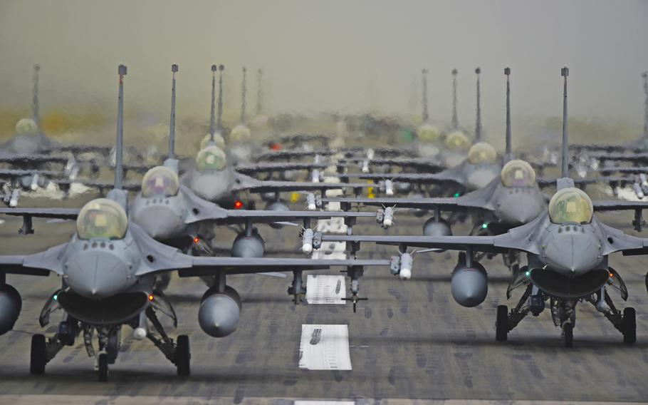 U.S. Air Force 52nd Fighter Wing F-16 jets line up in formation on the runway at Spangdahlem Air Base, Germany, Oct. 1, 2019. Spangdahlem is home to the only F-16 squadron in Germany. It might move under President Donald Trump's plan to remove 9,500 troops from Germany, The New York Times reported Friday.