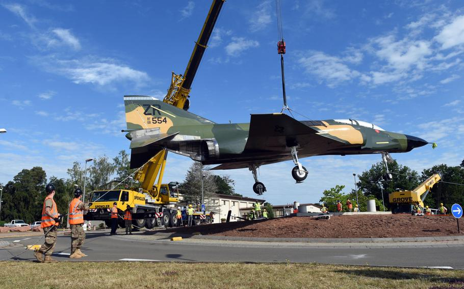 Personnel at Ramstein Air Base, Germany, help move a refurbished F-4 Phantom fighter jet to the traffic circle by the northside gym on Monday, June 8, 2020, where it is on static display.