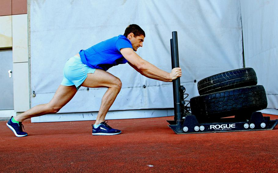 U.S. Army Lt. Col. Eric Palicia pushes a weighted sled while working out on Clay Kaserne, Germany, on April 21, 2020. Palicia and his brother, Air Force Capt. Noah Palicia, stationed at Yokota Air Base, Japan, are now competing on The Titan Games, which is airing on NBC.
