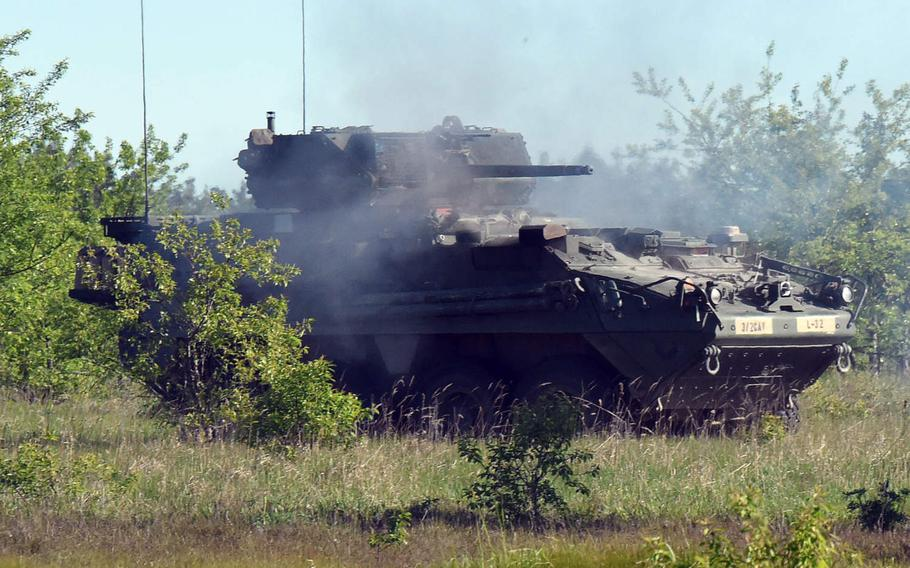Soldiers with 3rd Squadron, 2nd Cavalry Regiment supporting the Enhanced Forward Presence Battle Group fire in a Stryker armored vehicle during an exericse on Bemowo Piskie Training Area in Orzysz, Poland on June 2, 2020. The U.S. and Poland are still negotiating an American troop boost in Poland, officials from both countries have said.