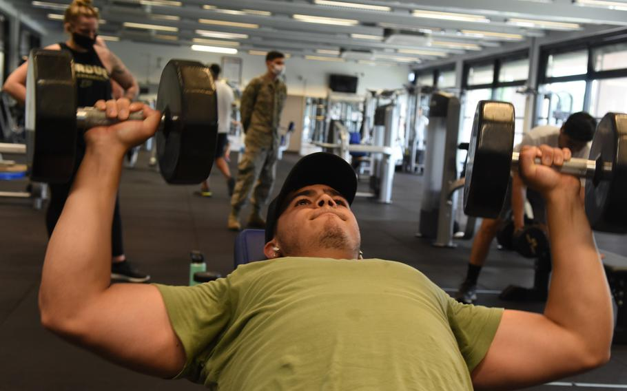 Airman Jared Chapa lifts dumbbells on the incline bench press on Monday, June 8, 2020, at the Southside Fitness Center on Ramstein Air Base, Germany. The main gym on Ramstein reopened to service members for the first time Monday since closing its doors in March due to the coronavirus.