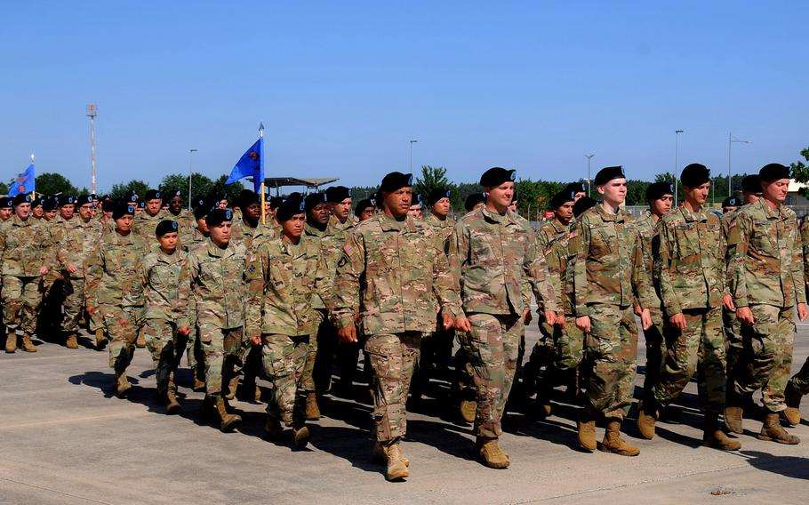 Soldiers with the 12th Combat Aviation Brigade march at Katterbach Army Airfield in Ansbach, Germany, in July 2019. While President Trump confirmed Monday that he intends to pull 9,500 troops from Germany, the U.S. has not yet finalized plans on how or when to cut the troop levels, NATO's top official said.