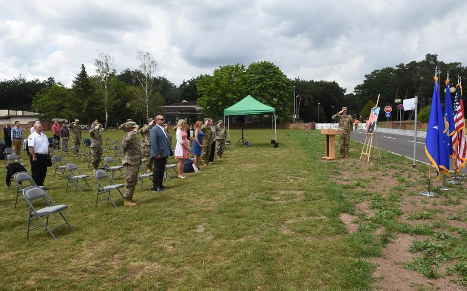Guests stand at attention at a ceremony to dedicate a new road at Ramstein Air Base, Germany, named after the late Air Force Maj. Rodolfo Rodriguez on June 16, 2020.