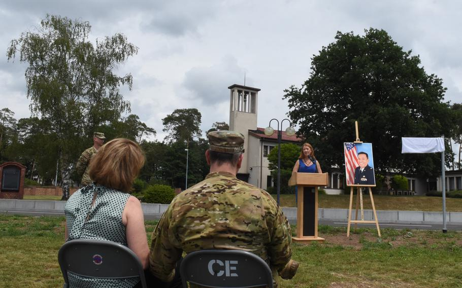 Brig. Gen. Mark August, the 86th Airlift Wing commander, listens to remarks by Caryn Rodriguez during a road dedication ceremony on Tuesday, June 16, 2020, at Ramstein Air Base, Germany. Rodriguez Road is named after Rodriguez's late husband, Air Force Maj. Rodolfo Rodriguez.