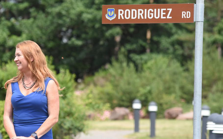 Caryn Rodriguez stands next to the road sign named after her late husband, Air Force Maj. Rodolfo Rodriguez. The newly paved road at Ramstein Air Base, Germany, was dedicated to Rodriguez at a ceremony on Tuesday, June 16, 2020.