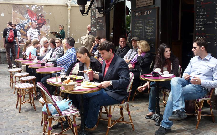A cafe in the Montmartre district of Paris in pre-coronavirus, social distancing days. Personnel assigned to U.S. Army Garrison Rheinland Pfalz may travel internationally but only to about 25 countries in Europe, a new general order from 21st TSC says.