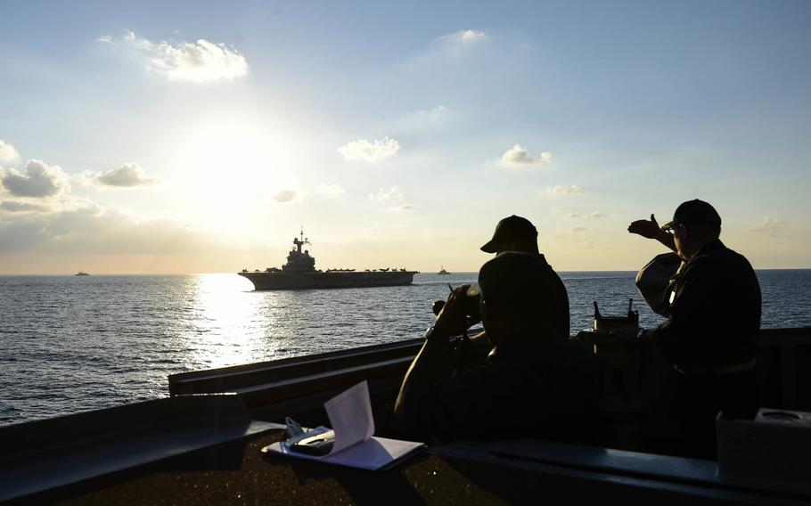 Sailors aboard USS Ross watch as the ship takes part in an exercise with the French Charles de Gaulle carrier strike group in the eastern Mediterranean in 2016. A buildup by Russia is turning the eastern Mediterranean Sea into one of the world's most militarized zones, Adm. James Foggo, head of U.S. Naval Forces Europe and Africa, says.