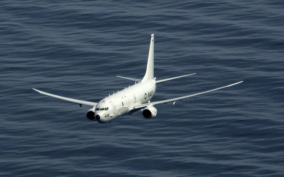 A P-8A Poseidon maritime patrol and reconnaissance aircraft flies over the Atlantic Ocean during an exercise, March 29, 2020. Two Poseidons, the guided-missile destroyer USS Roosevelt and the submarine USS Indiana are participating in Dynamic Mongoose 2020 in the north Atlantic.