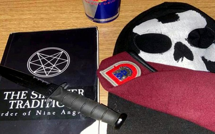 This photo provided by the Justice Department seized from an iCloud account belonging to Army Pvt. Ethan Melzer, displays personal effects, including paraphernalia associated with the extremist group Order of the Nine Angles. Melzer pleaded not guilty on Monday, July 6, 2020, to charges he conspired with the satanic neo-Nazi group to plot an ambush on his unit during a planned deployment to Turkey.