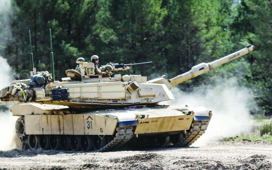 A U.S. Army tank maneuvers a trail at Drawsko-Pomorskie Training Area, Poland, in April 2020. Soldiers from 1st Armored Brigade Combat Team, 1st Cavalry Division, out of Fort Hood, Texas, are headed for Poland to participate in a Defender-Europe 20 exercise.
