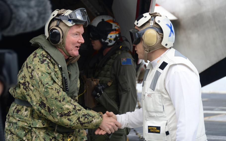 Adm. James G. Foggo III shakes hands with Capt. Daniel Prochazka, the executive officer of the aircraft carrier USS Harry S. Truman, on the flight deck in the Mediterranean Sea Dec. 9, 2019. Foggo relinquished command July 17, 2020, of U.S. Naval Forces Europe-Africa.