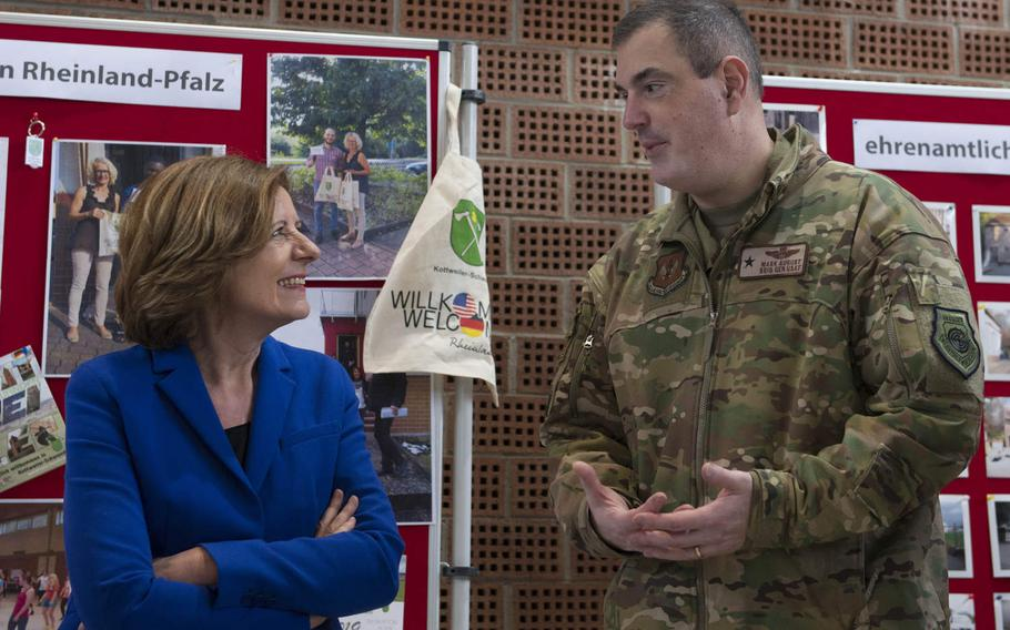 Rheinland-Pfalz Minister President Malu Dreyer speaks with 86th Airlift Wing commander Brig. Gen. Mark August in Kottweiler-Schwanden, Germany, in February 2020. Dreyer is one of four German state heads that sent a letter to U.S. lawmakers, urging them to oppose troop cuts in the country.