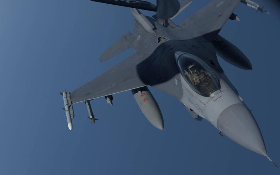 A U.S. Air Force F-16 Fighting Falcon assigned to Aviano Air Base's 31st Fighter Wing prepares to receive fuel from a KC-135 Stratotanker assigned to RAF Mildenhall's 100th Air Refueling Wing, over the Black Sea, July 22, 2020.