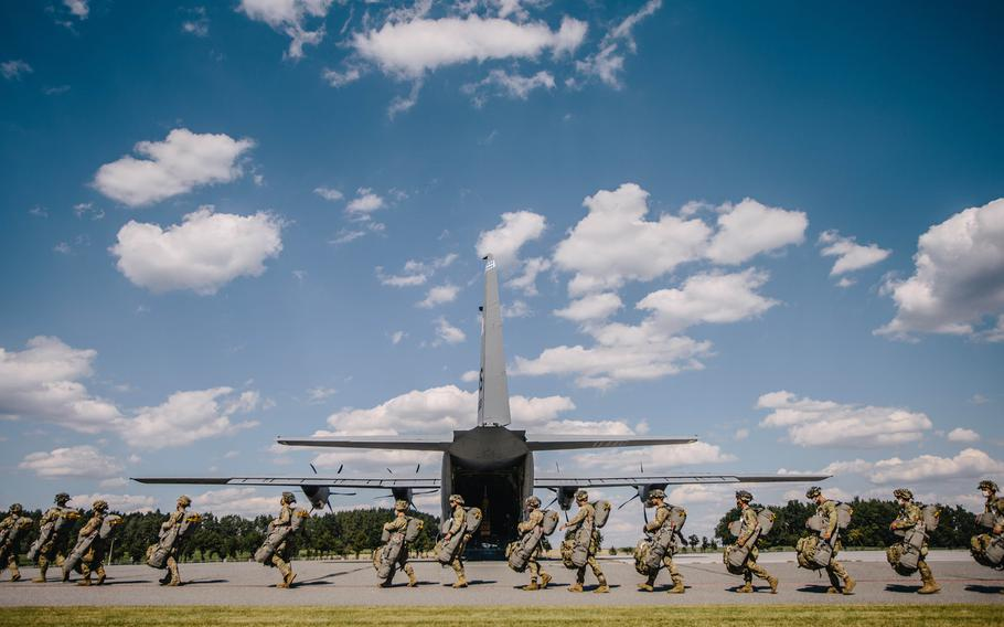 U.S. paratroopers assigned to the 173rd Airborne Brigade make their way to an aircraft for airborne operations at Grafenwoehr Training Area, Germany, July 23, 2020, in preparation for Exercise Saber Junction 20.