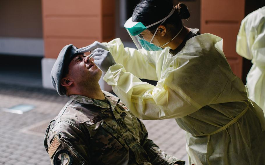 An airman assigned to the U.S. Army's 173rd Airborne Brigade is tested for the coronavirus on Caserma Del Din, Italy prior to departing for a training rotation in Germany, July 13, 2020.