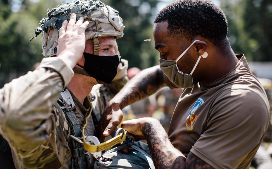 U.S. paratroopers assigned to the 173rd Airborne Brigade conduct inspections prior to a jump at Grafenwoehr Training Area, Germany, July 23, 2020.