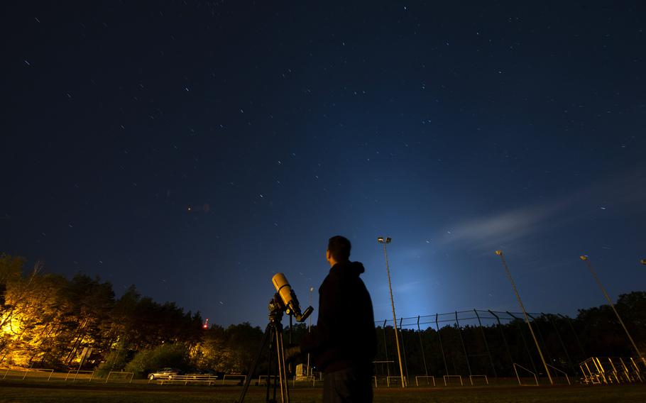 """Airman 1st Class Daniel Sanchez, 86th Airlift Wing Public Affairs broadcast journalist, observes the night sky on Kapaun Air Station, Germany, May 16, 2020. Sanchez, who has a passion for space exploration, coined the motto """"Semper Supra"""" for the U.S. Space Force and one day hopes to serve in the military's newest service branch."""