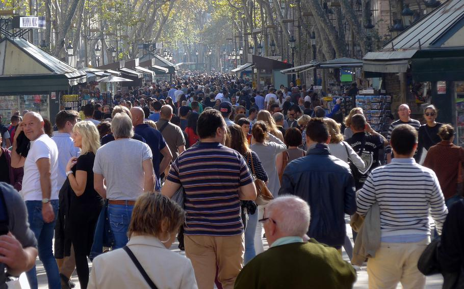 People stroll down Barcelona, Spain's famed Las Ramblas in pre-coronavirus times. Official military travel for U.S. European Command personnel to Belgium and Spain now requires official approval, but leisure travel is allowed. Policy at some commands within Europe remained unclear Tuesday. German health officials have cautioned that the Spanish regions of Catalonia, which includes Barcelona, along with Navarre and Aragon, are risk areas and travel could require a quarantine upon return to Germany.