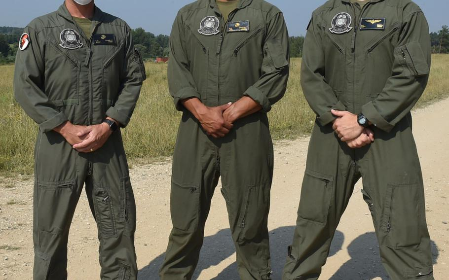 Master Sgt. Lucas Schultz, from left, maintenance chief with the Special Purpose Marine Air-Ground Task Force-Crisis Response-Africa 20.2, Lance Cpl. Robert Bristol, an MV-22 Osprey airframe mechanic, and Capt. Elijah Smith, an MV-22 Osprey pilot, pose for a photo in Grafenwoehr, Germany, on Aug. 10, 2020, during Exercise Saber Junction.