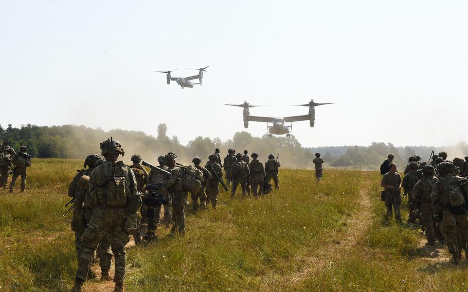 Soldiers with the 173rd Airborne Brigade prepare to be transported on Marine MV-22 Ospreys in Grafenwoehr, Germany, on Aug. 10, 2020, during Exercise Saber Junction. The Marines flew at least three Ospreys around 1,200 miles from Moron in Spain to Grafenwoehr for the exercise.