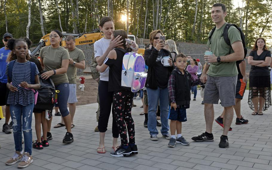 Parents wish their children a good day as they arrive for the first day of school at Vogelweh Elementary School, Aug. 26, 2019. This year, students and staff members must wear masks when a 6-foot social distance can't be maintained.