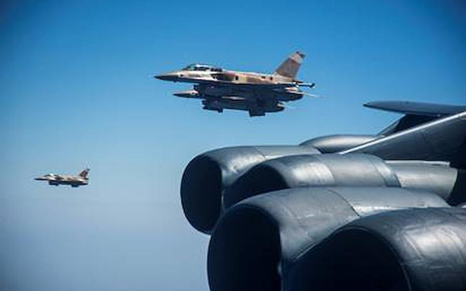 Two Moroccan F-16s fly alongside a U.S. Air Force B-52H Stratofortress from the 5th Bomb Wing out of Minot Air Force Base, N.D., Sept. 7, 2020.