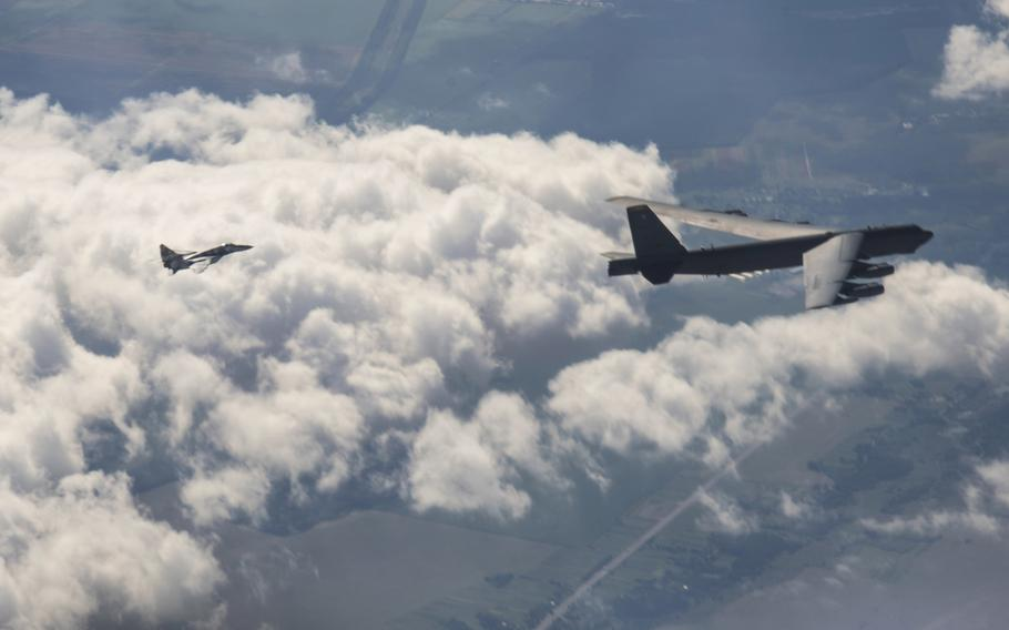 A U.S. B-52H Stratofortress from the 5th Bomb Wing, Minot Air Force Base, N.D.,flies with with a Ukrainian MiG-29 for a Bomber Task Force Europe mission over Ukraine, Sept. 4, 2020.