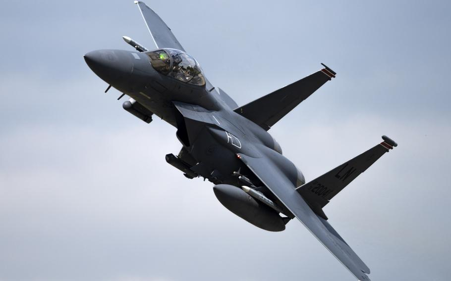 An F-15E Strike Eagle, assigned to the 494th Fighter Squadron, flies overhead at RAF Lakenheath, England, Sept. 1, 2020.