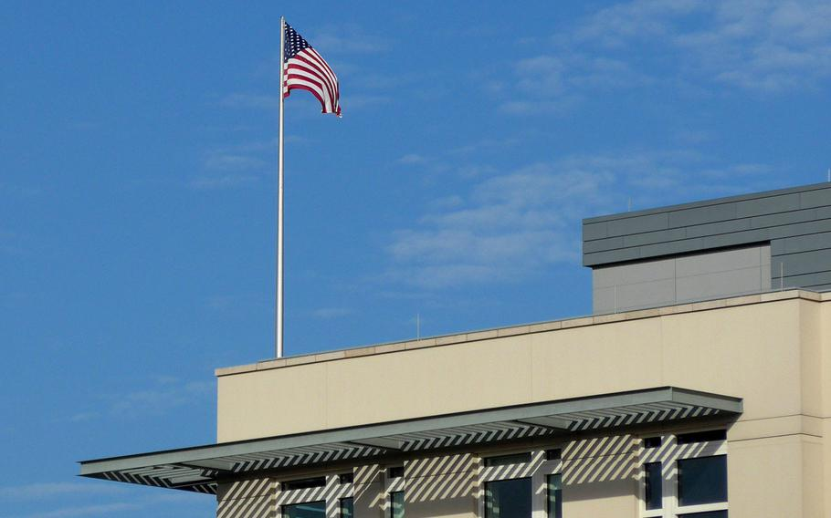 The American flag flies over the U.S. embassy in Berlin, Germany. The embassy is getting involved in a dispute with Germany over whether troops and Defense Department civilians who have NATO Status of Forces Agreement protections, are obligated to pay German taxes.
