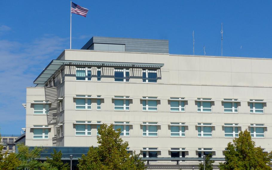 The American flag flies over the U.S. embassy in Berlin, Germany. High-level U.S. diplomats are getting involved in a dispute with Germany over whether troops and Defense Department civilians who have NATO Status of Forces Agreement protections, are obligated to pay German taxes.  Michael Abrams/Stars and Stripes
