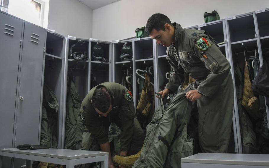 Two U.S. Air Force pilots from the 555th Fighter Squadron, Aviano Air Base, Italy, put on gear at Graf Ignatievo Air Base, Bulgaria, Sept. 21, 2020. The pilots participated in Thracian Viper 20, a multilateral training exercise with the Bulgarian air force.