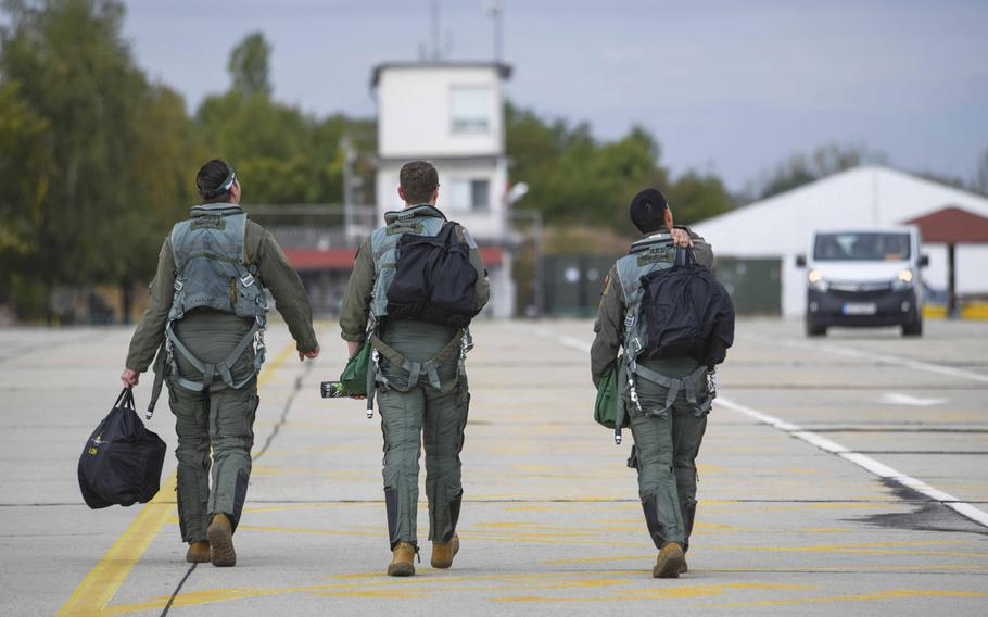 Three U.S. Air Force pilots from the 555th Fighter Squadron, Aviano Air Base, Italy, walk toward their aircraft at Graf Ignatievo Air Base, Bulgaria, Sept. 21, 2020. The pilots participated in Thracian Viper 20, a multilateral training exercise.