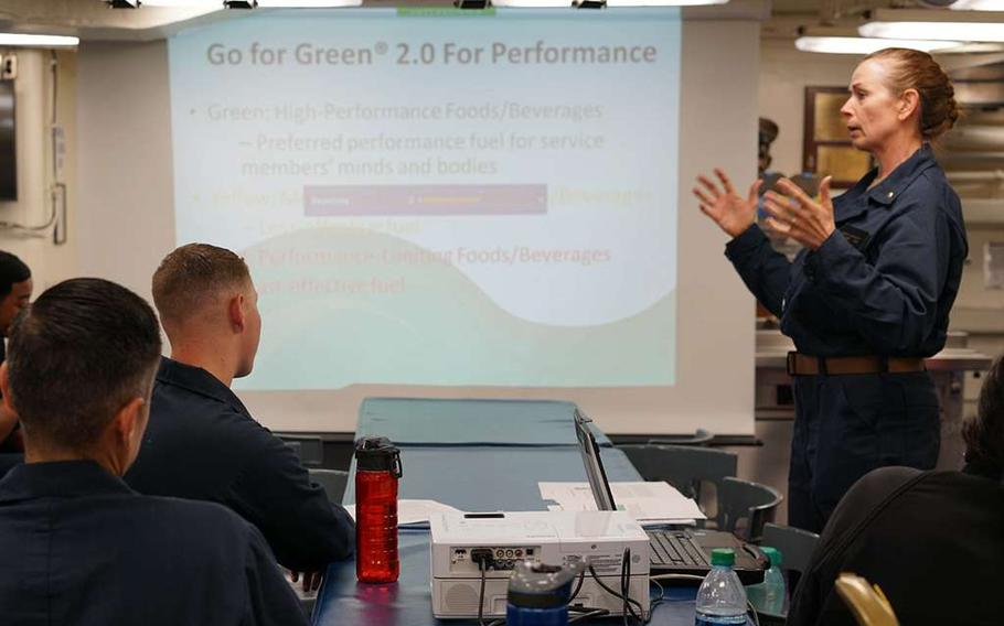 Navy registered dietitian Lt. Pamela Gregory teaches sailors aboard the destroyer USS John Finn about the Go for Green 2.0 program during her seven-day temporary duty assignment to educate sailors on performance nutrition, healthy eating habits, hydration and safe dietary supplement use, Nov. 11, 2018.