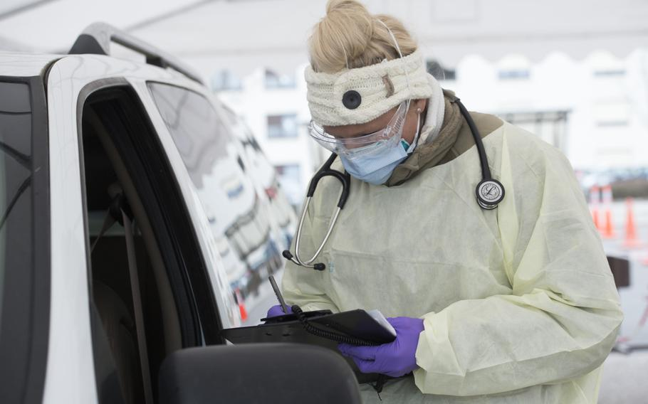 Staff Sgt. Maxime Copley, 86th Medical Group, takes patient information at the coronavirus screening drive-thru at Ramstein Air Base, Germany, March 31, 2020. Germany on Wednesday reported more than 4,000 new infections, while Kaiserslautern earlier this week listed eight new active cases among U.S. forces in its area.