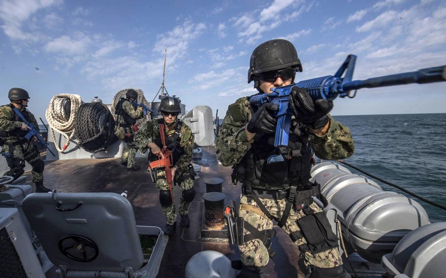 Sailors assigned to the  guided-missile destroyer USS Carney conduct a security sweep of the forecastle aboard the Bulgarian navy ship BuNS Bodri as part of a visit, board, search and seizure drill during exercise Sea Breeze on the Black Sea in 2019. The two countries on Oct. 8, 2020 signed a 10-year road map for defense cooperation that puts increased focus on security around the Black Sea.