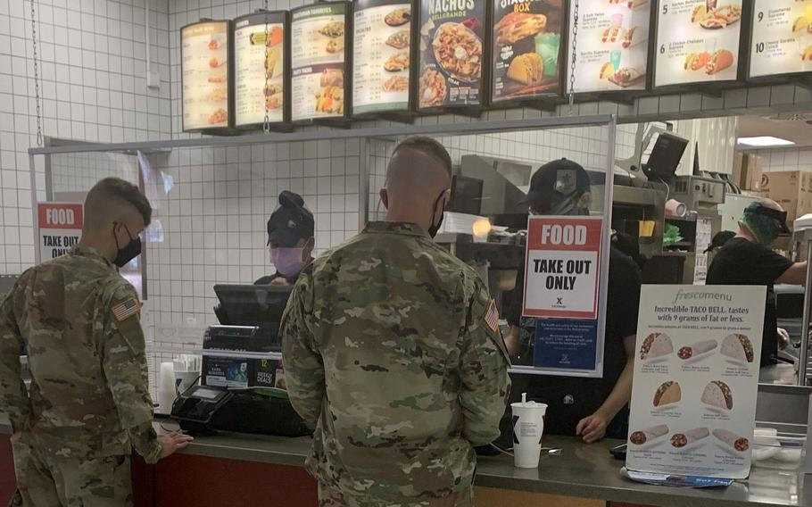 U.S. soldiers order fast food on Tower Barracks in Grafenwoehr, Germany, Nov. 2, 2020, where a sign reads ''Takeout Only.'' Eateries are restricted to providing only takeout or delivery meals starting Nov. 2, 2020, as U.S. Army Garrison Bavaria toughened up coronavirus rules to try to flatten the curve of a second wave in Germany.