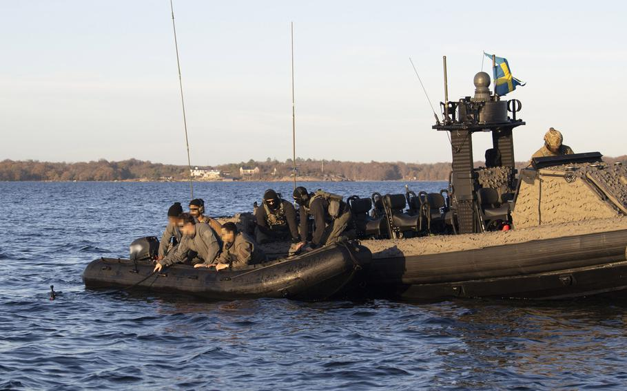 Swedish special forces together with U.S. Navy special warfare combatant-craft crewmen and special reconnaissance unmanned underwater vehicle operators assigned perform launch and recovery training using a Combatant Craft Medium in the Baltic Sea near Karlskrona, Sweden during a bilateral exercise on Nov. 6, 2020.