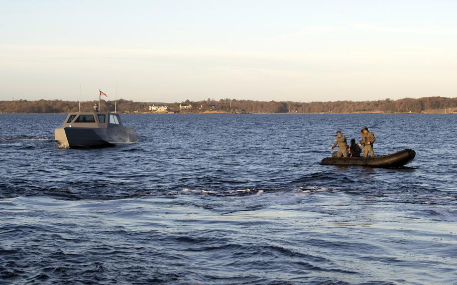 U.S. Navy special warfare combatant-craft crewmen and special reconnaissance unmanned underwater vehicle operators launch and recover an unmanned underwater vehicle using a Combatant Craft Medium in the Baltic Sea near Karlskrona, Sweden, during a bilateral exercise on Nov. 6, 2020.