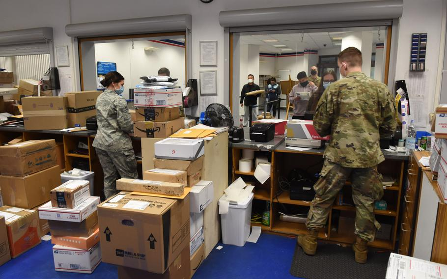 Military postal clerks Staff Sgt. Kaela Roberts and Senior Airman Ronnie Crawford work the finance window at the Ramstein Northside Post Office at Ramstein Air Base, Germany, on Friday, Nov. 13, 2020. Postal clerks are spending extra time inputting custom forms manually as the U.S. Postal Service?s new electronic customs form system has been riddled with problems.