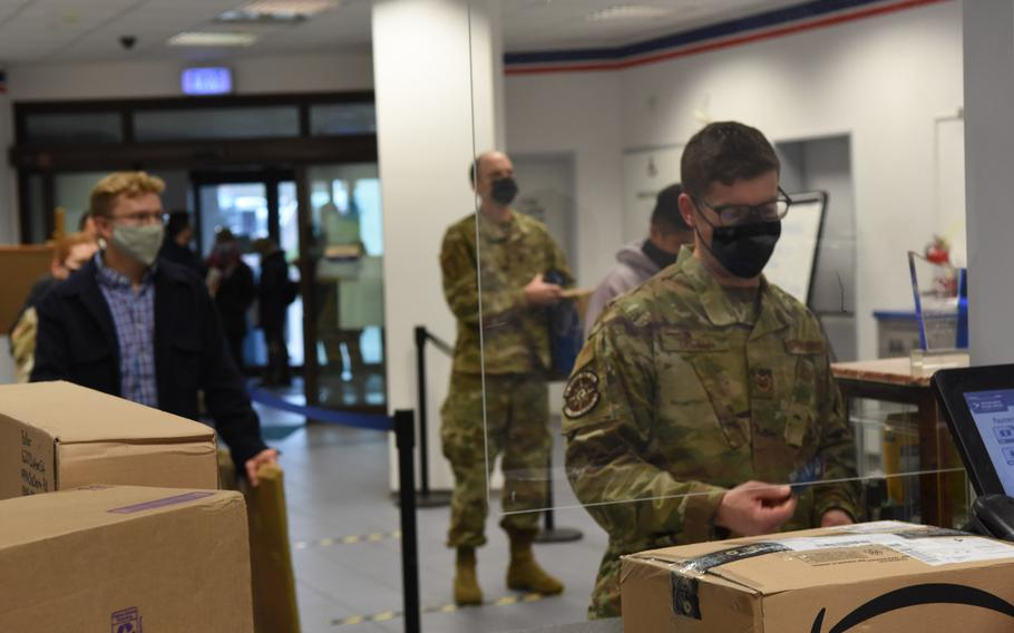 A long line forms on Nov. 13, 2020, at the Northside Post Office at Ramstein Air Base, Germany, as customers wait to mail packages. Many customers have been unable to fill out electronic customs forms required since September by the U.S. Postal Service, leading to longer wait times as postal clerks input the information manually.