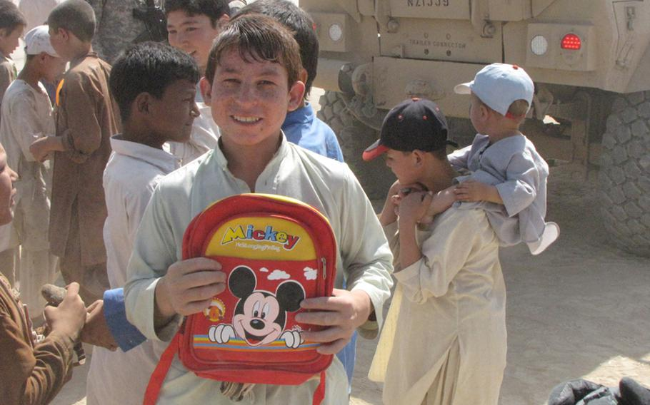 A young Marjab boy comes away with a Mickey Mouse backpack.