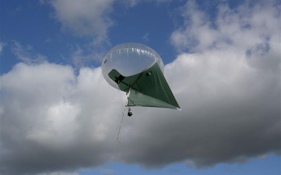 The military is testing part-blimp, part-kite Helikites as another option for aerial surveillance, as this one is shown flying in June of 2007.