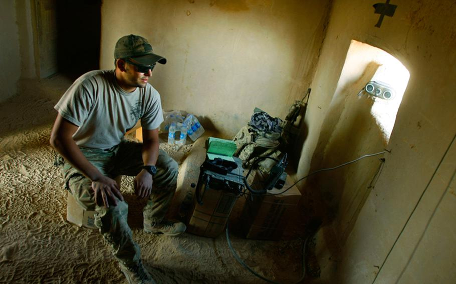 Spc. Alex Sweredoski with Company F, 4th Battalion, 101st Aviation Regiment, 159th Combat Aviation Brigade, 101st Airborne Division, mans a radio at Battle Position Osman near the village of Kuchnay Shur in Zabul province, Afghanistan on September 14, 2011.  The battle position was named after Staff Sgt. Ergin Osman, who was killed on May 26, 2011 in an improvised explosive device attack.